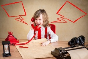 Shouting child businessman with retro phone. Success communication business concept